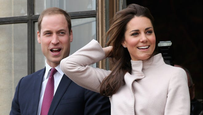Prince William and Catherine Duchess of Cambridge on balcony in visit to Cambridge.