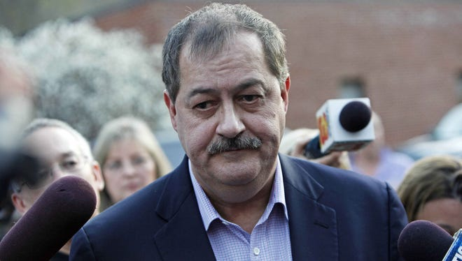 Massey Energy CEO Don Blankenship speaks to reporters in Montcoal, W. Va., on April 6, 2010.