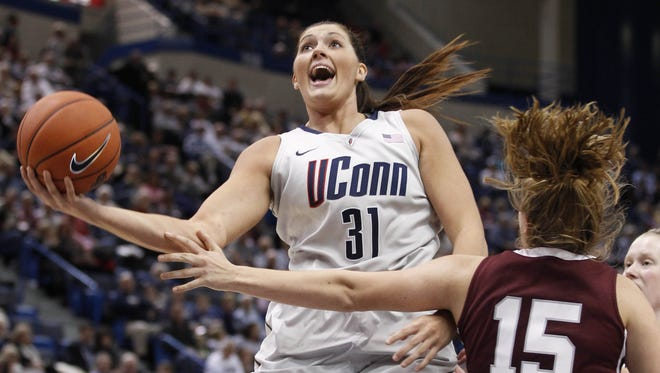 Connecticut Huskies center Stefanie Dolson  drives the ball to the basket during the second half at the XL Center. UConn defeated the Colgate Raiders 101-41.