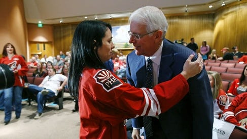 Phoenix fan Ronda Pearson hugs potential Coyotes owner Greg Jamison during the Glendale City Council meeting on Tuesday.
