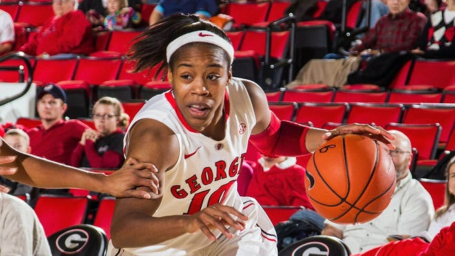 Georgia Bulldogs guard Jasmine James drives to the basket in the first half against the Furman Lady Paladins at Stegeman Coliseum.