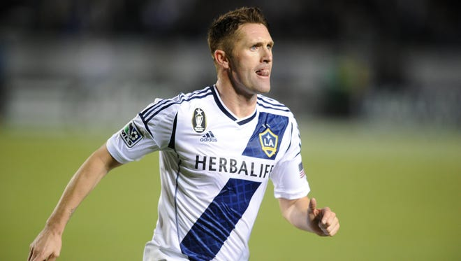 Los Angeles Galaxy forward Robbie Keane  celebrates with his team after scoring a goal against the Seattle Sounders during the first half at the Home Depot Center on Nov. 11.