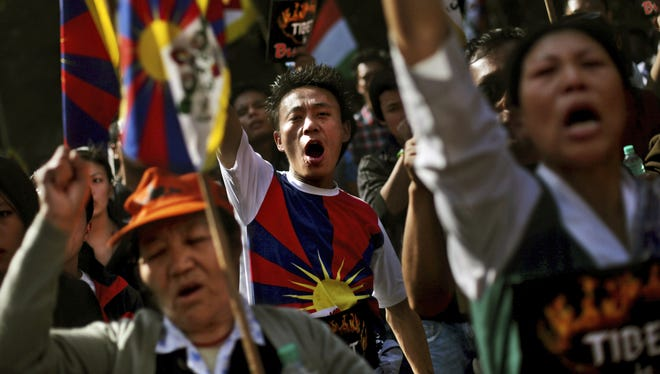 Exiled Tibetans in New Delhi, India, on Wednesday shout slogans during a  protest rally to express solidarity with Tibetans who have self-immolated, and to appeal for immediate international intervention. At least 86 people have set themselves on fire since the immolations began in 2009.