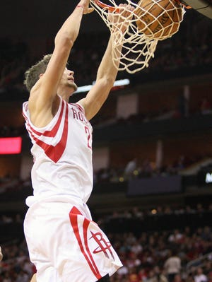 Rockets forward Chandler Parsons, dunking against the Knicks on Nov. 23, has a right shoulder injury.