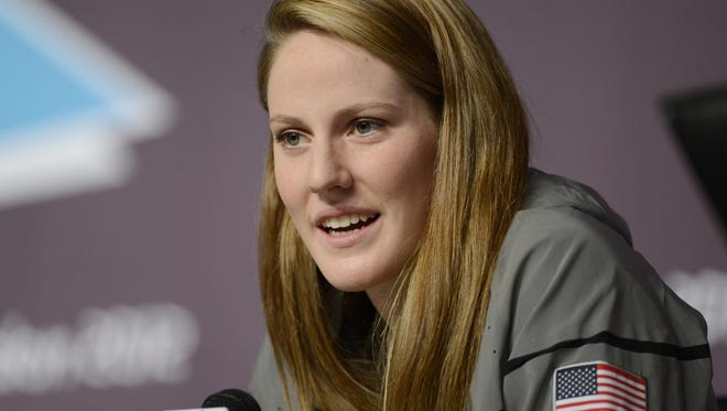 Missy Franklin speaks during a news conference at the London Olympics on Aug 11. The high school senior announced she'll swim for her Regis Jesuit team.