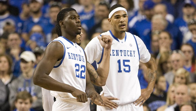 Kentucky Wildcats forward Alex Poythress (22) and forward Willie Cauley-Stein (15)  figure things out during a timeout in the game against the LIU Brooklyn Blackbirds at Rupp Arena. Kentucky defeated LIU Brooklyn 104-75.