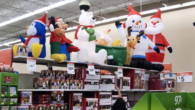 People shop inside a Walmart store in Norwalk, Conn.