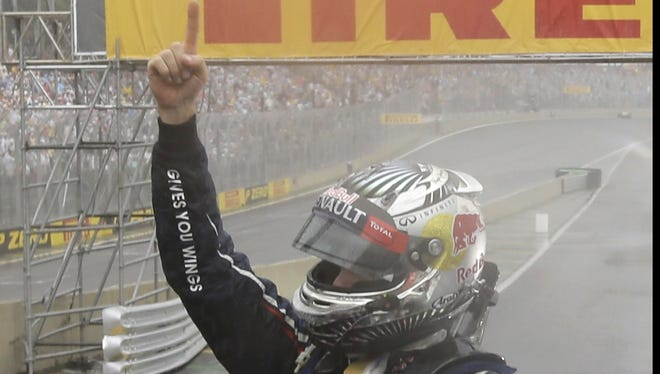 Red Bull driver Sebastian Vettel recovered from an early crash to finish sixth in the Brazilian Grand Prix, giving him his third F1 crown.