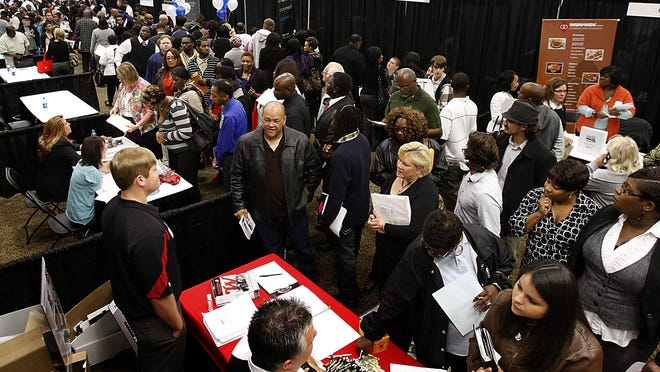 Hundreds of job applicants attend the DeSoto County Job Fair at Landers Center, in Southaven, Miss.