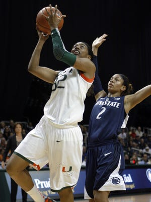 Miami's Morgan Stroman, left, scores on a layup past Penn State's Dara Taylor for two of her team-high 15 points.