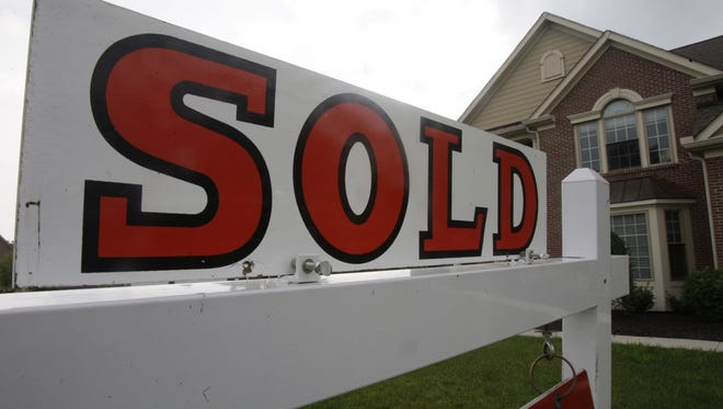 A sold sign is posted outside a home in Cincinnati in this file photo.