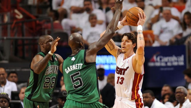 Miami Heat shooting guard Mike Miller (13) is defended by Boston Celtics power forward Kevin Garnett (5) and small forward Mickael Pietrus (28). Pietrus, a free agent, has signed with Toronto.