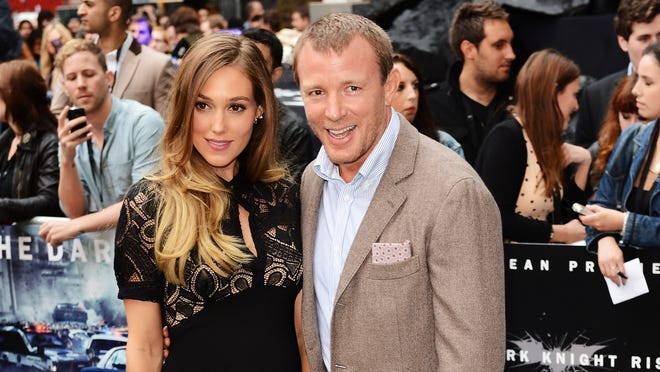"""Guy Ritchie and Jacqui Ainsley are engaged according to reports October 9, 2012.  Ritchie was previously married to Madonna from 2000 â?? 2008.  LONDON, ENGLAND - JULY 18:  Filmmaker Guy Richie andJacqui Ainsley attend the European premiere of """"The Dark Knight Rises"""" at Odeon Leicester Square on July 18, 2012 in London, England.  (Photo by Ian Gavan/Getty Images)"""