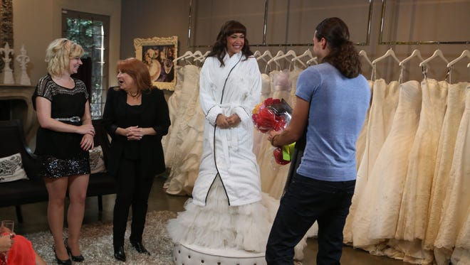 Ace Young presents flowers to Diana Degarmo as Beverly Hills wedding stylist Renee Strauss and Jessica Cameron watch on TLC's 'Beverly Hills Brides.'