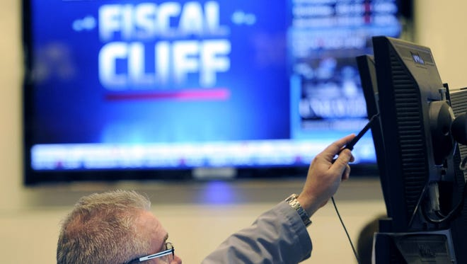 """Stocks declined for a third day on Wall Street Wednesday  as investors waited for signs of progress on the """"fiscal cliff."""""""