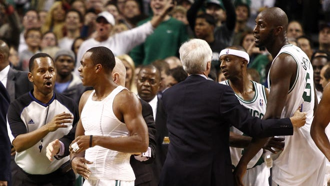 A referee and Celtics coaches and staff members try to separate Celtics guards Rajon Rondo and Jason Terry and center Kevin Garnett from Brooklyn Nets players after an altercation late in the second quarter of Wednesday's game.