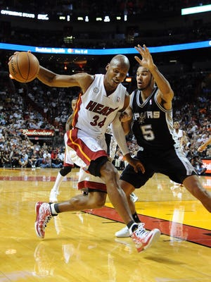 Heat guard Ray Allen shakes Spurs guard Cory Joseph during a 105-100 win Thursday.