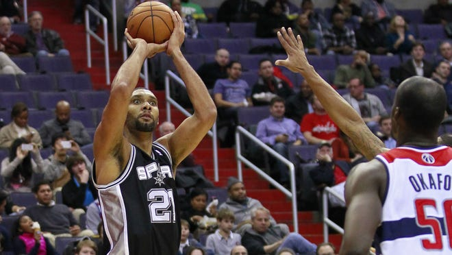 Spurs power forward Tim Duncan faces up for another of his patented bank shots in a game Monday night against the Washington Wizards.
