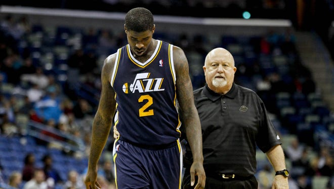 Utah Jazz power forward Marvin Williams (2) leaves the game after hitting the floor hard during the second half against the New Orleans Hornets at the New Orleans Arena.