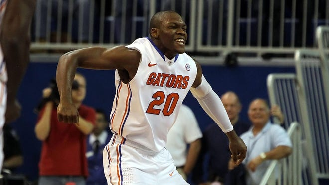 Florida guard Michael Frazier celebrates after knocking down one of five three-pointers in the 82-49 rout of Marquette.