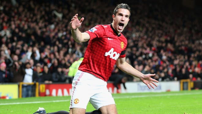 Robin van Persie of Manchester United celebrates  as he scores their first goal during the Barclays Premier League match between Manchester United and West Ham United at Old Trafford on November 28, 2012 in Manchester, England.