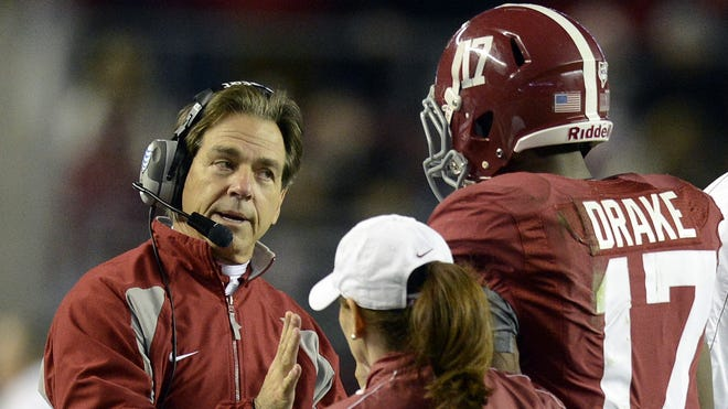 Alabama Crimson Tide head coach Nick Saban talks with Alabama Crimson Tide running back Kenyan Drake (17) following a fumble in their game against the Auburn last week.