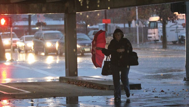 Bobbi Berg runs out of the rain Thursday in Redding, Calif. Heavy rain struck the city Thursday afternoon, and more is likely through the weekend.