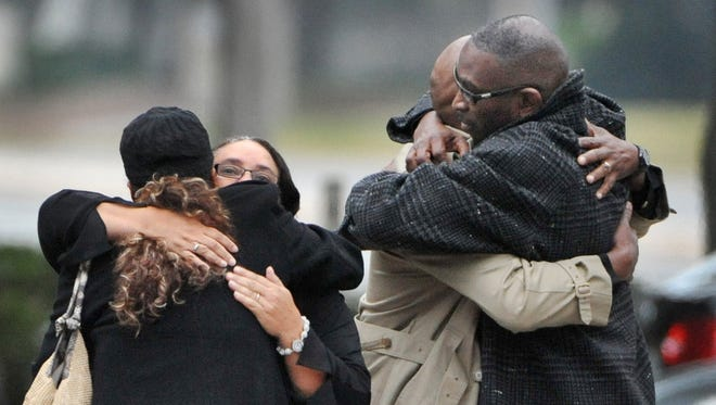 Ron Davis, the father of Jordan Davis is embraced as he arrives at the funeral home for the visitation and a memorial service for his son Jordan.
