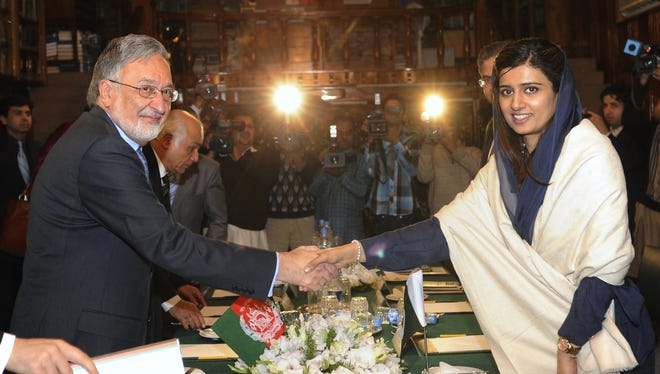Afghan Foreign Minister Zalmay Rasoul, left, shakes hands with his Pakistani counterpart Hina Rabbani Khar.