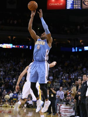 Nuggets star Andre Iguodala shoots a three-pointer that was ruled to be after the buzzer Thursday in a 106-105 loss to the Warriors.