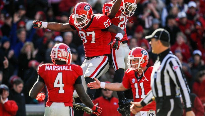 Georgia tight end Jay Rome (87), wide receiver Malcolm Mitchell (26) after a touchdown in the second half of a 42-10 win over Georgia Tech last Saturday at Sanford Stadium. After a difficult offseason and rough start to the regular season, Georgia has had much to celebrate and plays for a national championship berth this week.