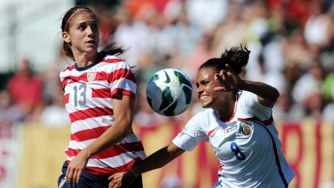 Alex Morgan (13) and Costa Rica defender Daniela Cruz (8) fight for control of the ball in a friendly at Sahlen's Stadium on Sept. 1, 2012.