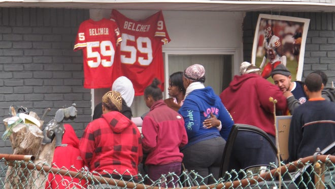 Friends and relatives of Kansas City Chiefs linebacker Jovan Belcher grieve outside the player's home on Dec. 1 in West Babylon, N.Y. Police said the Long Island native shot and killed his girlfriend before taking his own life on Saturday in Kansas City.