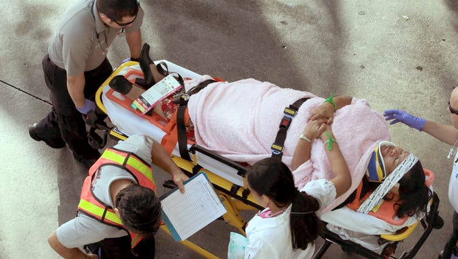 Emergency personnel attend to injured passengers after a bus accident at Miami International Airport on Dec. 1.