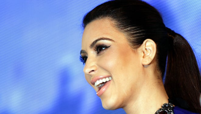TV star Kim Kardashian, speaks to fans in Riffa, Bahrain, on Saturday.