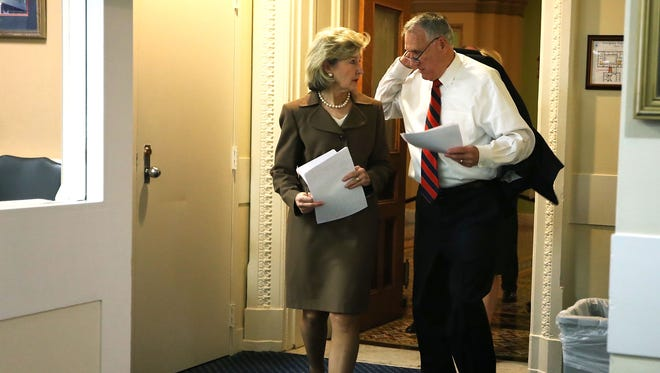 U.S Senator Kay Bailey Hutchison (R-Tex.)  and Senator Jon Kyl (R-Ariz.) are shown Nov. 27 before a news conference on immigration reform on Capitol Hill.