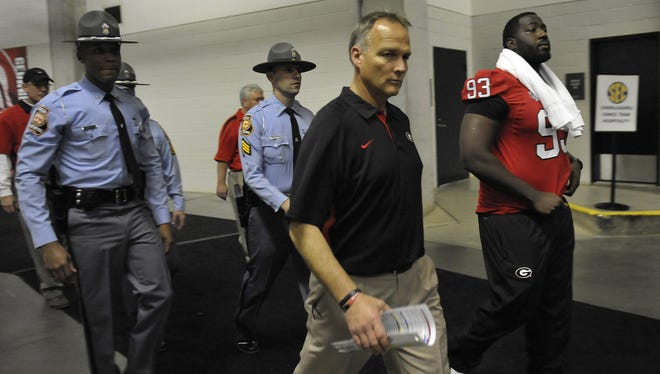 Georgia coach Mark Richt walks back to the locker room after losing the 2012 SEC Championship game against the Alabama Crimson Tide at the Georgia Dome. Alabama won 32-28.