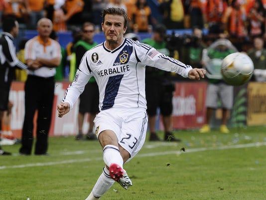 David Beckham attempting a long ball