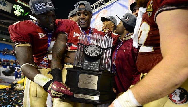 Florida State players celebrate with the ACC championship trophy after their 21-15 win over Georgia Tech.