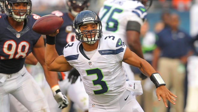 Russell Wilson stymied the Bears with his arm and legs Sunday.