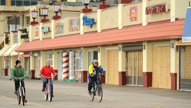 Visitors bike on Atlantic City's Boardwalk a week after superstorm Sandy made landfall.