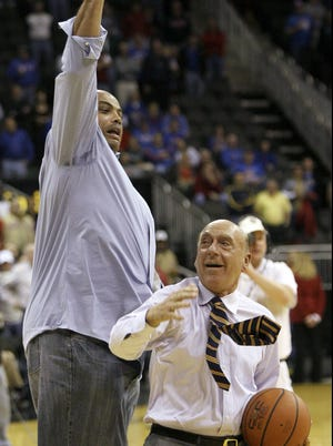 Charles Barkley, left, and Dick Vitale in 2008 play basketball during halftime of a CBE Classic college basketball tournament game between in Kansas City,  Mo.