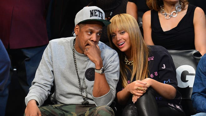Jay-Z and Beyonce attend the New York Knicks vs Brooklyn Nets game at Barclays Center on Nov. 26 in Brooklyn.