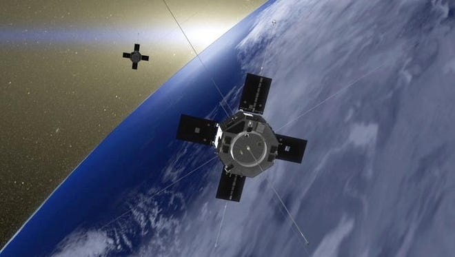 This undated image made available by NASA and the Goddard Space Flight Center shows an artist's rendition of the Van Allen Probes in orbit around Earth.