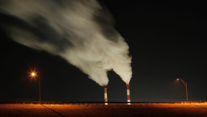 Smoke rises from the stacks of the La Cygne Generating Station coal-fired power plant in La Cygne, Kan. , on Jan. 19. The Natural Resources Defense Council, an environmental group, urged President Obama to limit the greenhouse gas emissions from all power plants -- not just new ones as the Environmental Protection Agency has proposed.