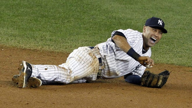 New York Yankees shortstop Derek Jeter (2) reacts after being injured while attempting to field a ball hit by Detroit Tigers shortstop Jhonny Peralta (not pictured) in the 12th inning during Game One of the 2012 ALCS.