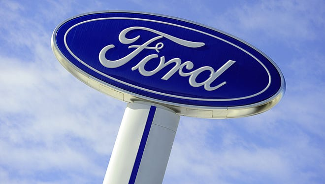 The Ford logo at a car dealership in Hudson, Wisc.