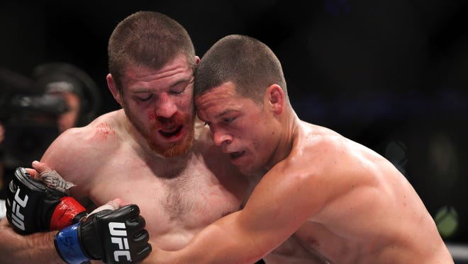 Nate Diaz (right) in action against Jim Miller during their lightweight bout at UFC on Fox at the Izod Center in E. Rutherford, N.J. on  May 5. Diaz won via tapout due to a choke in round 2.