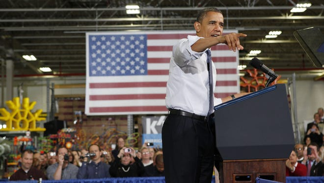 President Obama gestures as he speaks at The Rodon Group manufacturing about taxes.