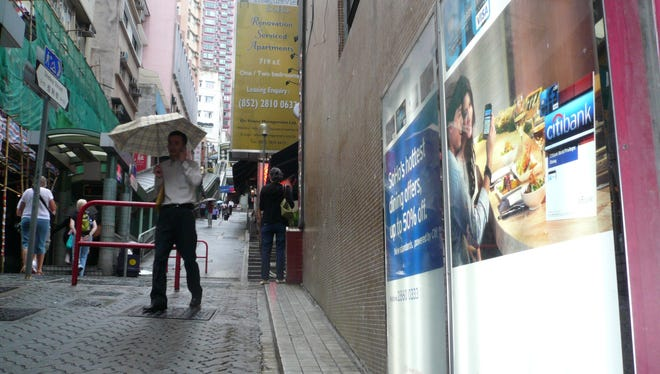 A Citibank credit card ad in Hong Kong. Citi said Dec. 5 that it will close some branches in Hong Kong. File.